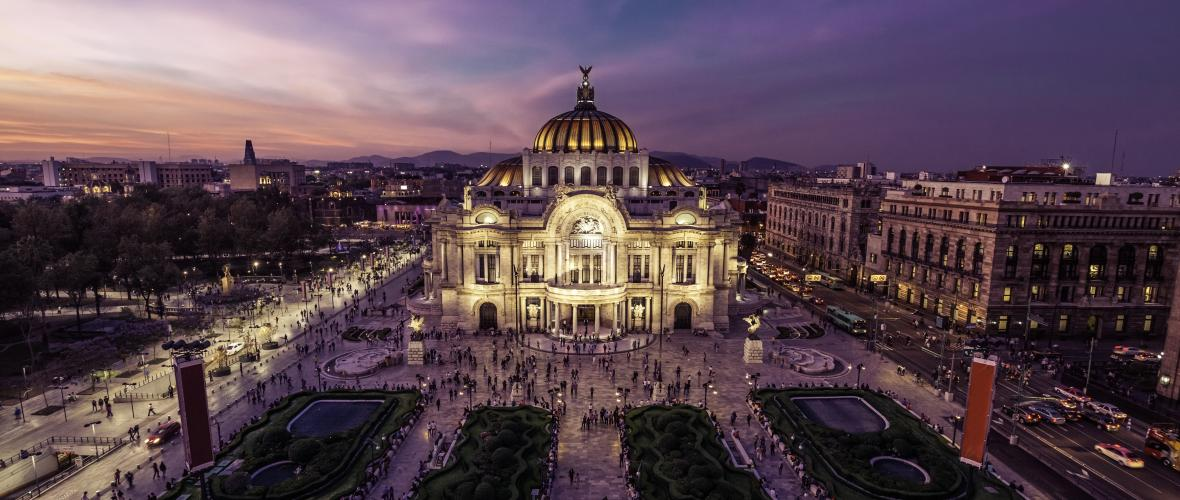An aerial view of the Historical Center of Mexico City, Mexico at dusk.