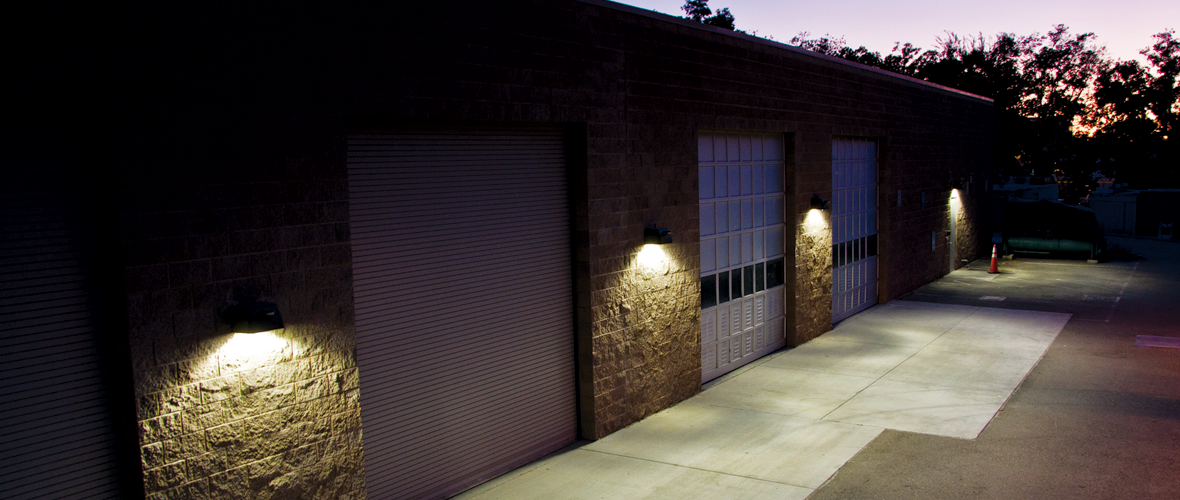 Adaptive LED wall packs alongside the exterior of a warehouse storage facility at the University of California, Davis (UCD).